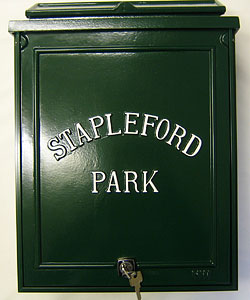 Here is a sample of a small personalised post box, with wording only, set out in Times Condensed lettering on a green background