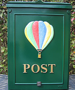 'Up up and away......'. When hot air balloons frequently fly over your house what could be a more appropriate choice of emblem than this beautiful hot air balloon? The word 'POST' is set out in gold Times lettering on a green background