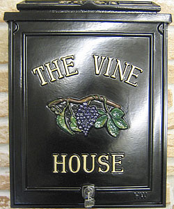 What more appropriate than this delicious-looking bunch of grapes for this house name, which is displayed on this small personalised post box in Times Condensed lettering.