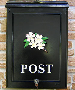 The details have been kept simple with the word POST set out in white Times lettering on this larger post box, with pretty pale cherry blossom.