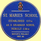 This school plaque has the school's crest at the top and the wording is set out in Times Condensed lettering in two sizes with the smaller text at the bottom in Helvetica.